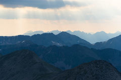 Sun rays shining above mountains in the morning Pyrenees Stock Photo