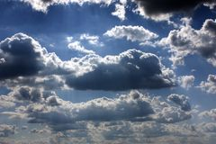 Sun rays shining through clouds Royalty Free Stock Photo