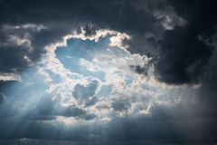 Sun rays shining through dark clouds after strom Royalty Free Stock Photography