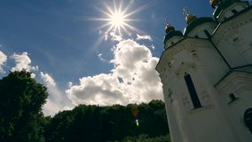 Sun rays shining down on a Church. Ukraine stock video