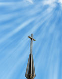 Sun rays shining down on cross Royalty Free Stock Image