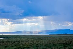 Sunrays thru stormy clouds. Sun rays shining thru stormy clouds at Song Kul lake, Kyrgyzstan Royalty Free Stock Photography