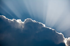 Sun rays shinning through a dark cloud Stock Photography