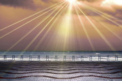 Sun rays from sky. Balustrade and empty terrace overlooking the sea Stock Photography