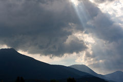Sun rays through storm clouds Stock Photo