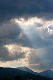 Sun rays through storm clouds Stock Image