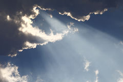 Sun rays through storm clouds Royalty Free Stock Photos