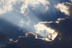 Sun rays through storm clouds Royalty Free Stock Photo
