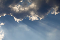 Sun rays through storm clouds Royalty Free Stock Images