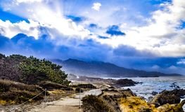 Sun Rays Through Storm Clouds at Point Lobos State Reserve Stock Photos
