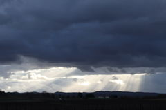Sun rays through storm clouds Royalty Free Stock Photography