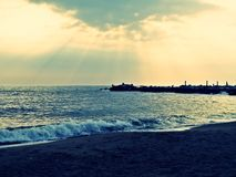 Sun rays at sunset. Over the sea in italy royalty free stock photos