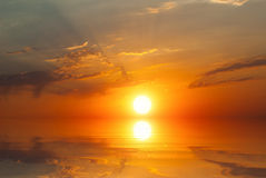 The sun, the rays - the sunset at sea Stock Image