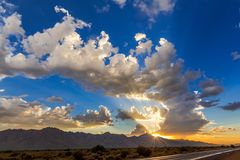 Sun rays at sunset after a storm. Sunset rays shining from behind a passing storm in the Arizona desert Stock Photography