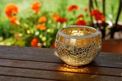 Sun rays touching glass candle jar royalty free stock photos