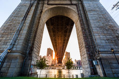 Sun rays under Queensboro bridge. Sun rays under Queensboro bridge at sunset on Roosevelt island, New York Royalty Free Stock Image