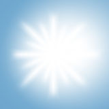 Sun rays. White sun rays on a light sky blue background Royalty Free Stock Photography