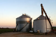 Sun Reflected on Corn Silos Stock Photo