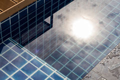 Sun reflected in swimming pool Royalty Free Stock Photos