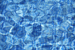 Sun reflected in the swimming pool water as a background Royalty Free Stock Images
