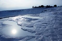 Sun is reflected in the travertines of Pamukkale. Turkey Royalty Free Stock Image