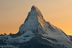 The sun is reflected on the walls of the Matterhorn royalty free stock photo
