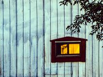 The sun is reflected in the window of my barn. Sunset reflected in the window of the barn. Photo taken in summer 2015 when the sun was setting, the orange color royalty free stock photography