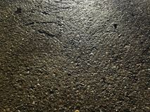 Sun reflecting on the concrete pavement. Blinded by the refection of the sun on the wet concrete pavement royalty free stock photography