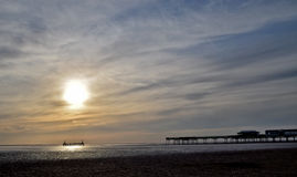Sun reflecting over old pier Royalty Free Stock Images