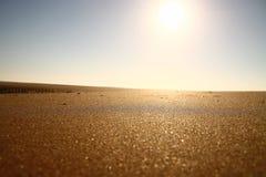 Sun reflecting on sand Stock Photo