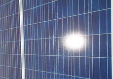Sun Reflecting in solar panel array Royalty Free Stock Photos