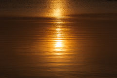 Sun reflecting in the surface of the water. Stock Photography