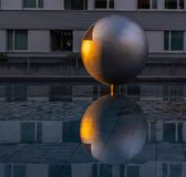 Sun reflection in ball of steel stock photo