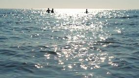 Sun reflection on sea surface. On sunset stock footage