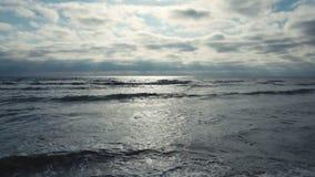 Sun reflection on sea surface. On sunset stock video footage