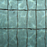 Pool water. Sun reflections in pool water from above Royalty Free Stock Photo