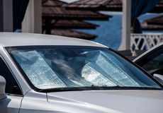 Sun Reflector windscreen. Protection of the car panel from direct sunlight. Protection of the car panel from direct sunlight. Sun Reflector windscreen royalty free stock photography