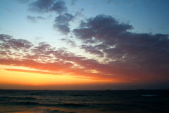 Sun rise. Beautiful spectacular clouds just before the sun rise in early morning colorful sky above the sea Stock Photography