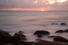 Sun rise on Anse de brick bay (Normandy) Stock Images