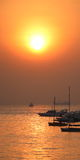 Sun. Rise captured with boats below Royalty Free Stock Photo