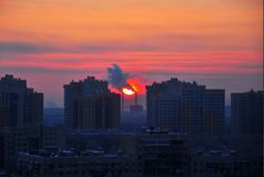 Sun rise in the city Winter morning Smog stock photo