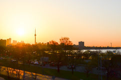 Sun rise and the CN Tower in Toronto royalty free stock images