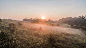 Sun rise at the farm house Stock Images