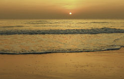 Sun rise on the golden beach Stock Images