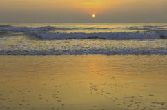 Sun rise on the golden sand Royalty Free Stock Photo