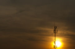 Sun rise. Morning Sun Phone antenna And gold sky Royalty Free Stock Photography