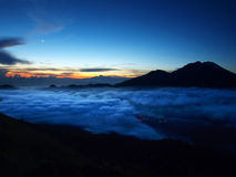 Sun rise from mount batur Stock Images