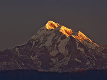 Sun rise on Mount Trishul Royalty Free Stock Images