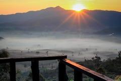 Sun rise on mountains Stock Photos