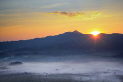 Sun rise on mountains Stock Images